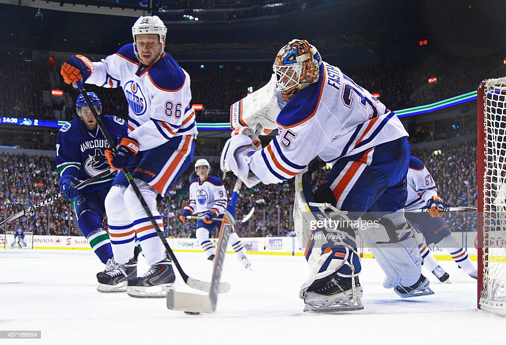 Nikita Nikitin of the Edmonton Oilers looks on as teammate Viktor Fasth plays the puck during their NHL game against the Vancouver Canucks at Rogers...