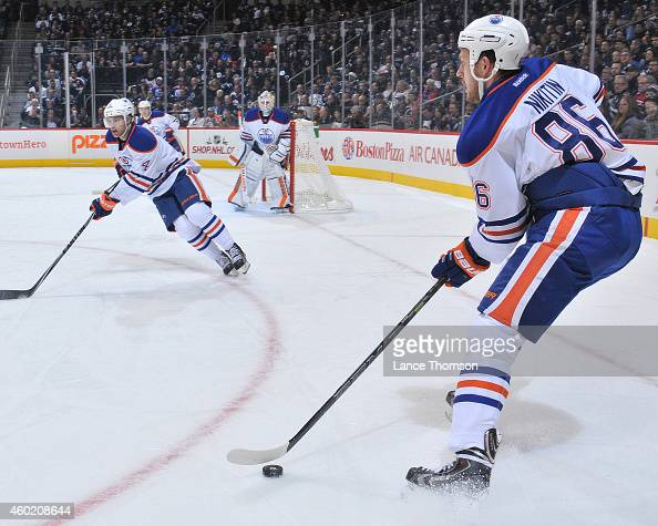 Nikita Nikitin of the Edmonton Oilers moves the puck up the ice during first period action against the Winnipeg Jets on December 3 2014 at the MTS...