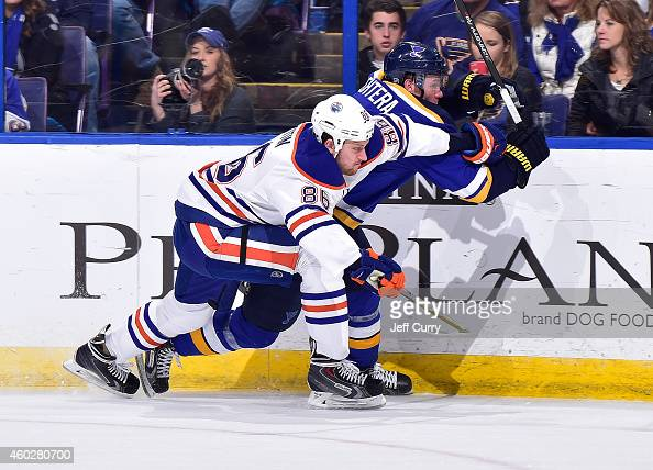 Nikita Nikitin of the Edmonton Oilers skates against Jori Lehtera of the St Louis Blues on November 28 2014 at Scottrade Center in St Louis Missouri