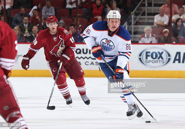 Nikita Nikitin of the Edmonton Oilers skates with the puck during the NHL game against the Arizona Coyotes at Gila River Arena on October 15 2014 in...