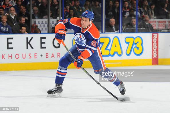Nikita Nikitin of the Edmonton Oilers takes a shot during the game against the Columbus Blue Jackets on March 18 2015 at Rexall Place in Edmonton...