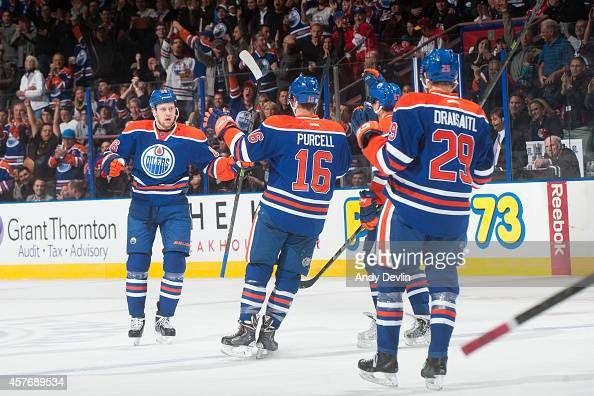 Nikita Nikitin Teddy Purcell and Leon Draisaitl of the Edmonton Oilers celebrate after a goal in a game against the Washington Capitals on October 22...