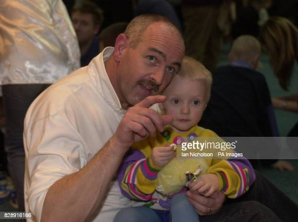 Nikita one of the children at the Zuzino street shelter in Moscow receives a visit from aid worker Brian Parkinson from Liverpool on the Russian...