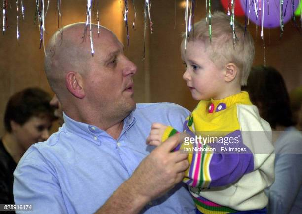 Nikita one of the children at the Zuzino street shelter in Moscow receives a visit from aid worker Dave Cook from Wrexham on the Russian Christmas...