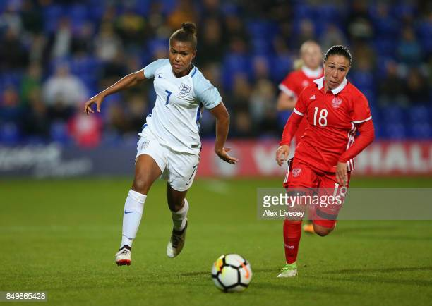 Nikita Parris of England beats Elvira Ziyastinova of Russia during the FIFA Women's World Cup Qualifier between England and Russia at Prenton Park on...