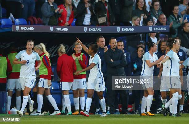 Nikita Parris of England celebrates after scoring the opening goal as Mark Sampson the manager of England looks on during the FIFA Women's World Cup...