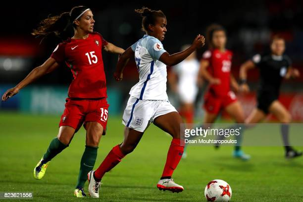 Nikita Parris of England holds off pressure from Carole Costa of Portugal during the UEFA Women's Euro 2017 Group D match between Portugal and...