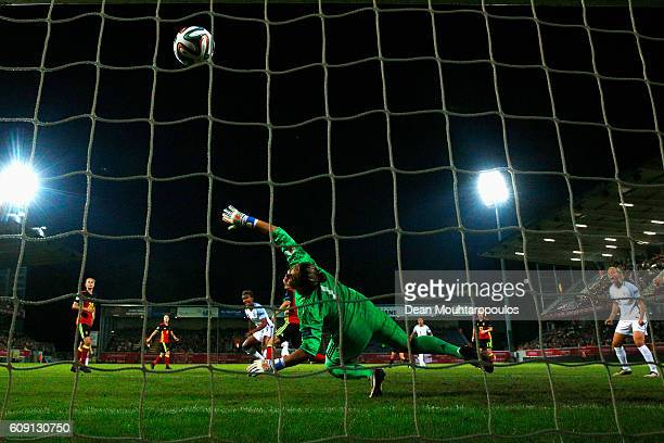 Nikita Parris of England scores her teams first goal of the game past Goalkeeper Justien Odeurs of Belgium during the UEFA Women's Euro 2017...
