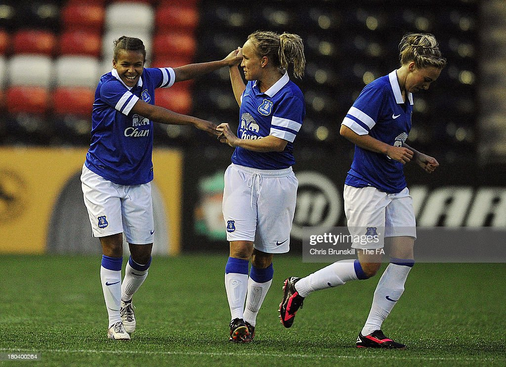 Nikita Parris of Everton Ladies FC is congratulated by teammate Jody Hanley after scoring the opening goal during the FA WSL match between Liverpool...
