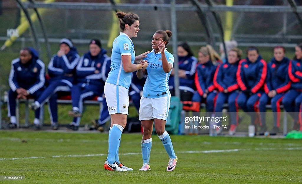 Nikita Parris of Manchester City (R) celebrates scoring the opening goal with Jennifer Beattie during the WSL 1 match between Sunderland AFC Ladies and Manchester City Women at The Hetton Center on April 29, 2016 in Hetton, England.