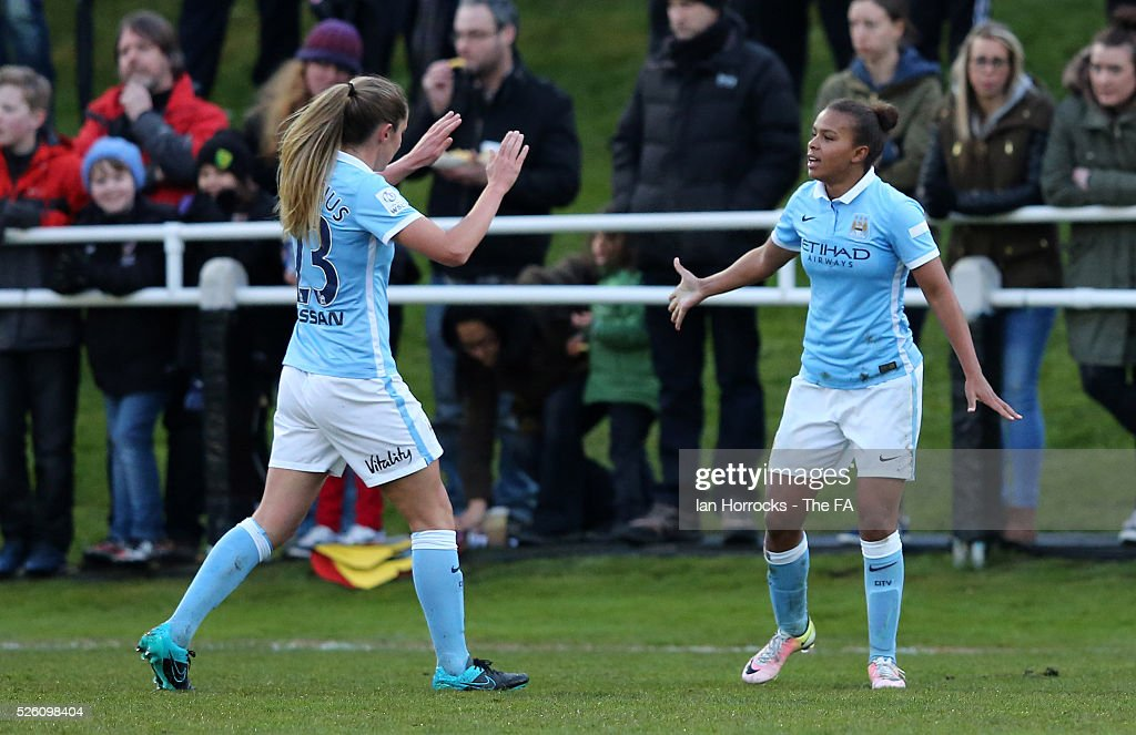 Nikita Parris of Manchester City (R) celebrates scoring the opening goal with Abi McManus during the WSL 1 match between Sunderland AFC Ladies and Manchester City Women at The Hetton Center on April 29, 2016 in Hetton, England.