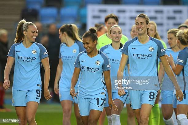 Nikita Parris of Manchester City celebrates winning the Women's Super Leauge 1 with her team mates Toni Duggan of Manchester City and Jill Scott of...