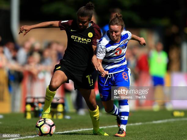 Nikita Parris of Manchester City holds off pressure from Remi Allen of Reading during the WSL 1 match between Reading FC Women and Manchester City...