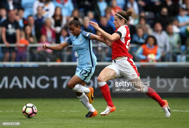 Nikita Parris of Manchester City Women battles with Dominique Janssen of Arsenal Ladies during the WSL 1 match between Manchester City Ladies and...