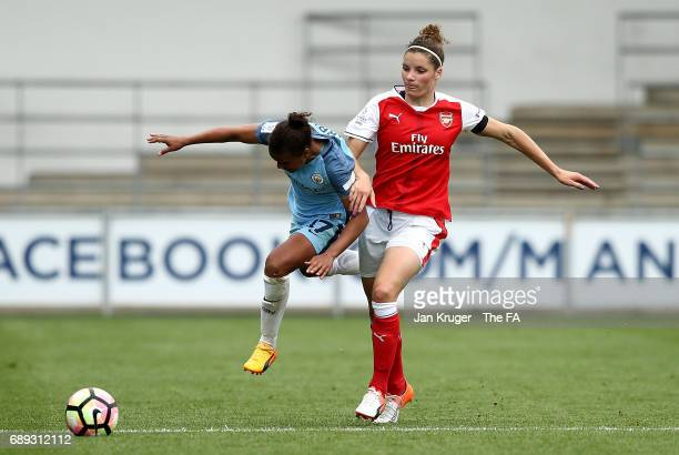 Nikita Parris of Manchester City Women is challenged by Dominique Janssen of Arsenal Ladies during the WSL 1 match between Manchester City Ladies and...