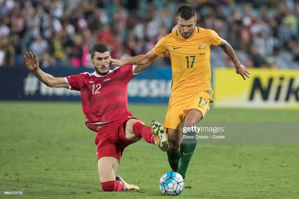 Nikita Rukavytsya of Australia competes for the ball with Syrias Esraa Alhamwiah during the 2018 FIFA World Cup Asian Playoff match between the Australian Socceroos and Syria at ANZ Stadium on October 10, 2017 in Sydney, Australia.