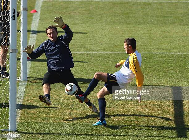 Nikita Rukavytsya of Australia scores past goalkeeper Eugene Galekovic during an Australian Socceroos training session at Ruimsig Stadium on June 20...