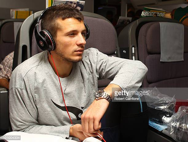 Nikita Rukavytsya of the Australian Socceroos relax inflight en route to Johannesburg in South Africa for the 2010 FIFA World Cup on May 26 2010