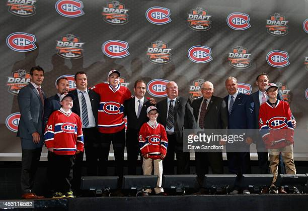 Nikita Scherbak smiles on stage after being selected 26th overall by the Montreal Canadiens during the 2014 NHL Entry Draft at Wells Fargo Center on...