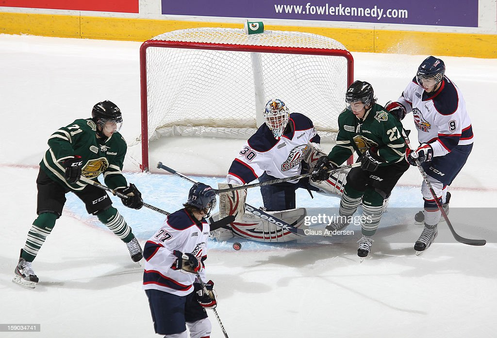 Nikita Serebryakov #30 of the Saginaw Spirit makes a save in an OHL game against the London Knights on January 4, 2013 at the Budweiser Gardens in London, Canada. The Knights defeated the Spirit 8-2.