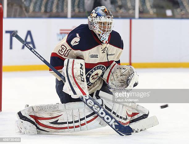 Nikita Serebryakov of the Saginaw Spirit stops a shot against the Windsor Spitfires in Game One of the OHL Winter Classic at Comerica Park on...