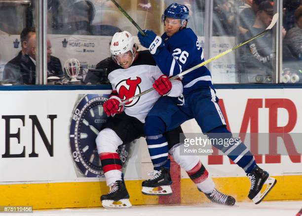 Nikita Soshnikov of the Toronto Maple Leafs checks Blake Coleman of the New Jersey Devils during the third period at the Air Canada Centre on...
