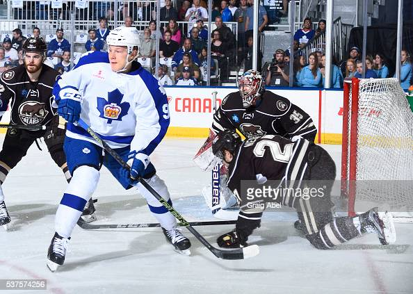 Nikita Soshnikov of the Toronto Marlies looks for the shot with Erik Burgdoerfer Justin Peters and Aaron Ness of the Hershey Bears during AHL Eastern...