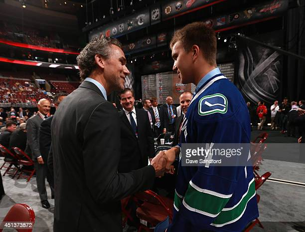 Nikita Tryamkin greets his team after being selected 66th overall by the Vancouver Canucks during the 2014 NHL Entry Draft at Wells Fargo Center on...