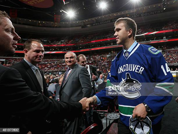 Nikita Tryamkin meets with his team after being drafted by the Vancouver Canucks on Day Two of the 2014 NHL Draft at the Wells Fargo Center on June...