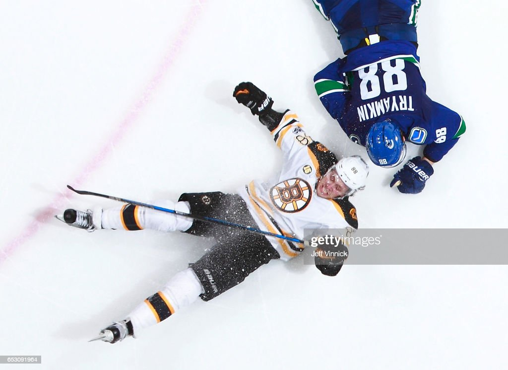 Nikita Tryamkin #88 of the Vancouver Canucks checks David Pastrnak #88 of the Boston Bruins during their NHL game at Rogers Arena March 13, 2017 in Vancouver, British Columbia, Canada. Boston won 6-3.