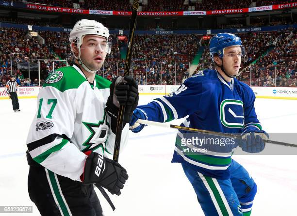 Nikita Tryamkin of the Vancouver Canucks checks Devin Shore of the Dallas Stars during their NHL game at Rogers Arena March 16 2017 in Vancouver...