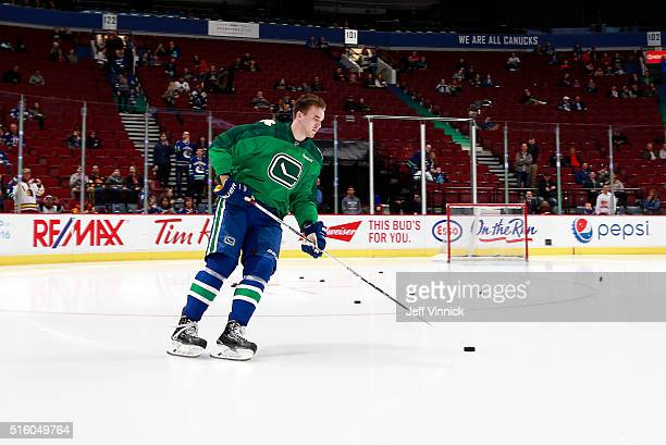 Nikita Tryamkin of the Vancouver Canucks skates alone to start warmup before his NHL debut against the Colorado Avalanche at Rogers Arena March 16...