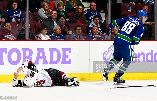 Nikita Tryamkin of the Vancouver Canucks skates away after colliding with Brad Richardson of the Arizona Coyotes during their NHL game at Rogers...