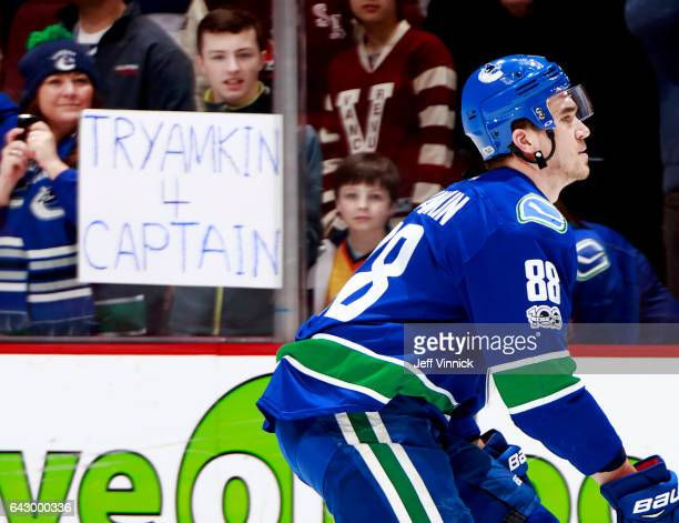 Nikita Tryamkin of the Vancouver Canucks skates past fans before his NHL game against the Philadelphia Flyers at Rogers Arena February 19 2017 in...
