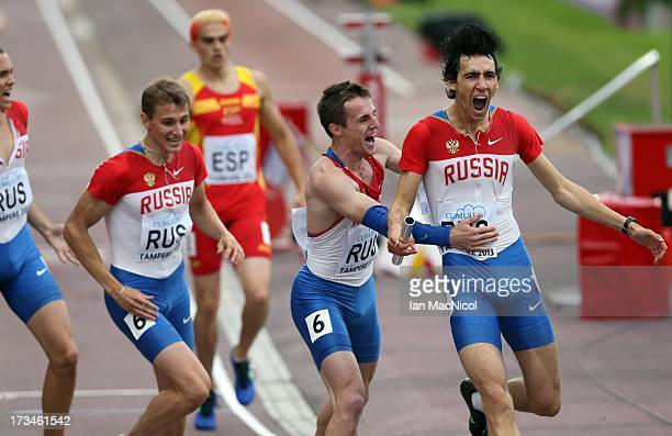 Nikita Uglov of Russia is congratulated by Denis Nesmashnyi after he leads his team to victory in the Men's 4x400m Final during day four of The...