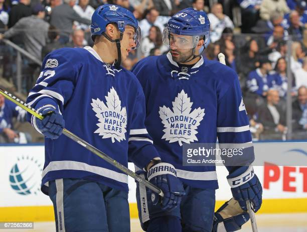 Nikita Zaitsev and Nazem Kadri of the Toronto Maple Leafs chat prior to a faceoff against the Washington Capitals in Game Six of the Eastern...