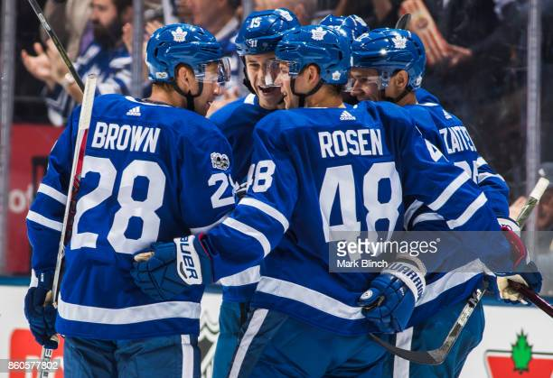 Nikita Zaitsev celebrates his goal with teammates Connor Brown Calle Rosen Matt Martin and Eric Fehr of the Toronto Maple Leafs against the Chicago...