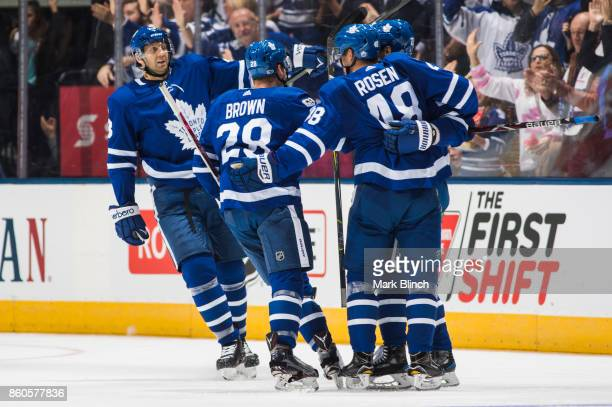 Nikita Zaitsev celebrates his goal with teammates Connor Brown Calle Rosen and Eric Fehr of the Toronto Maple Leafs against the Chicago Blackhawks...
