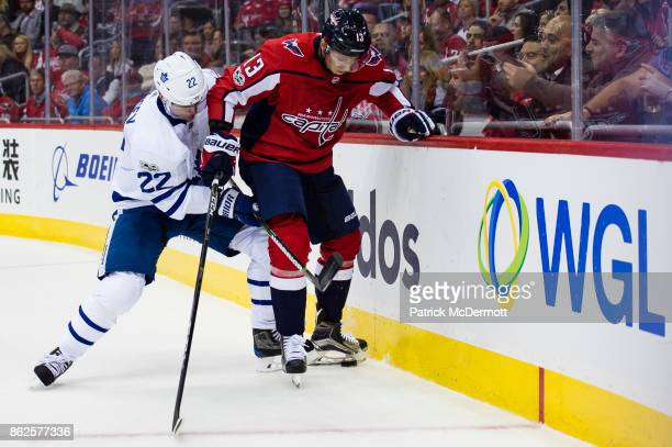 Nikita Zaitsev of the Toronto Maple Leafs and Jakub Vrana of the Washington Capitals battle for the puck in the third period at Capital One Arena on...