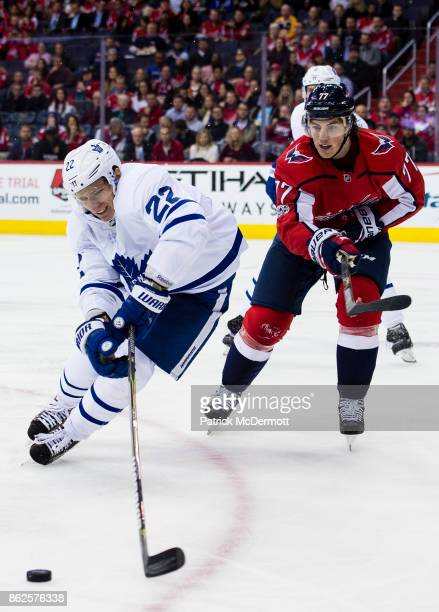 Nikita Zaitsev of the Toronto Maple Leafs and TJ Oshie of the Washington Capitals battle for the puck in the third period at Capital One Arena on...