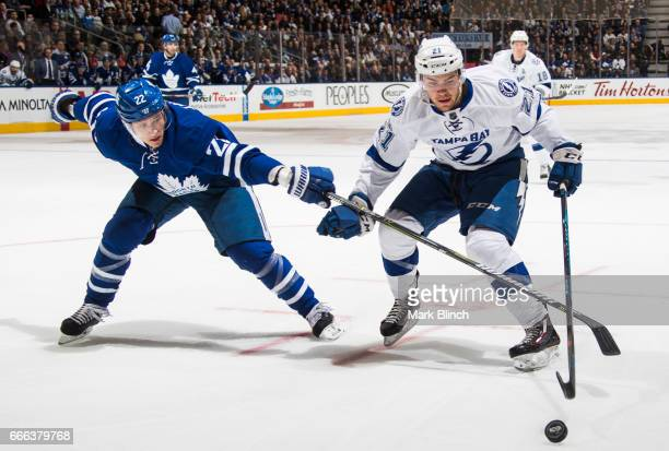 Nikita Zaitsev of the Toronto Maple Leafs battles with Brayden Point of the Tampa Bay Lightning during the second period at the Air Canada Centre on...