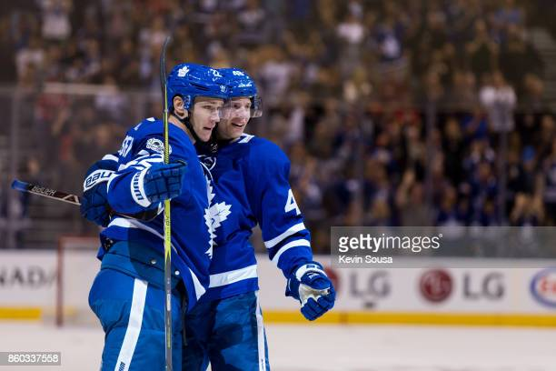 Nikita Zaitsev of the Toronto Maple Leafs celebrates his second period goal against the Chicago Blackhawks with teammate Calle Rosen on October 9...