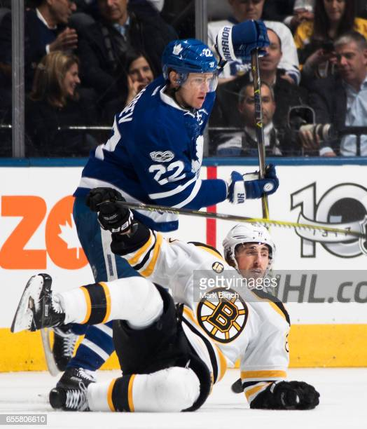Nikita Zaitsev of the Toronto Maple Leafs checks Brad Marchand of the Boston Bruins during the first period at the Air Canada Centre on March 20 2017...