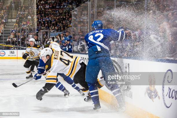 Nikita Zaitsev of the Toronto Maple Leafs lays a check on Torey Krug of the Boston Bruins during the first period at the Air Canada Centre on March...