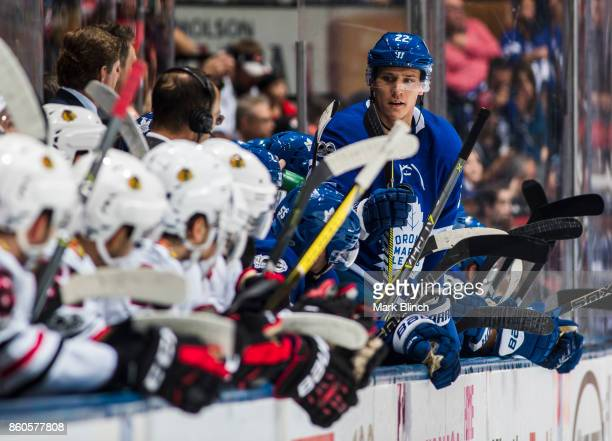 Nikita Zaitsev of the Toronto Maple Leafs stands on the bench during play against the Chicago Blackhawks during the second period October 9 2017 at...