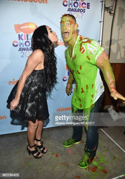 Nikki Bella and Host John Cena backstage at Nickelodeon's 2017 Kids' Choice Awards at USC Galen Center on March 11 2017 in Los Angeles California