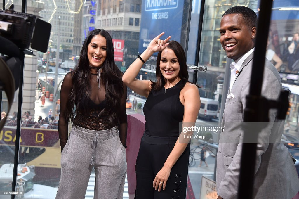 Nikki Bella, Brie Bella and AJ Calloway during a taping of The Bella Twins Visit 'Extra' at H&M Times Square on August 22, 2017 in New York City.