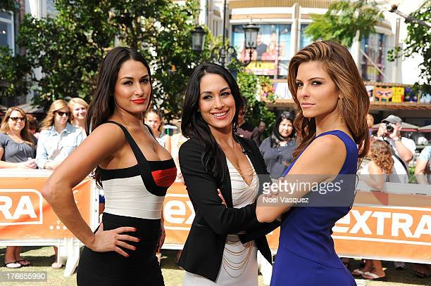 Nikki Bella Brie Bella and Maria Menounos visit 'Extra' at The Grove on August 16 2013 in Los Angeles California