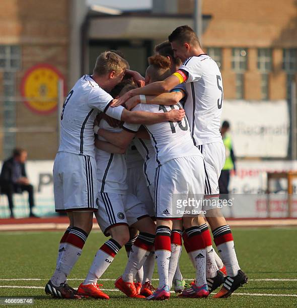 Nikki Beste of Germany celebrates with teammates after scoring the opening goal from the penalty spot during the international friendly match between...