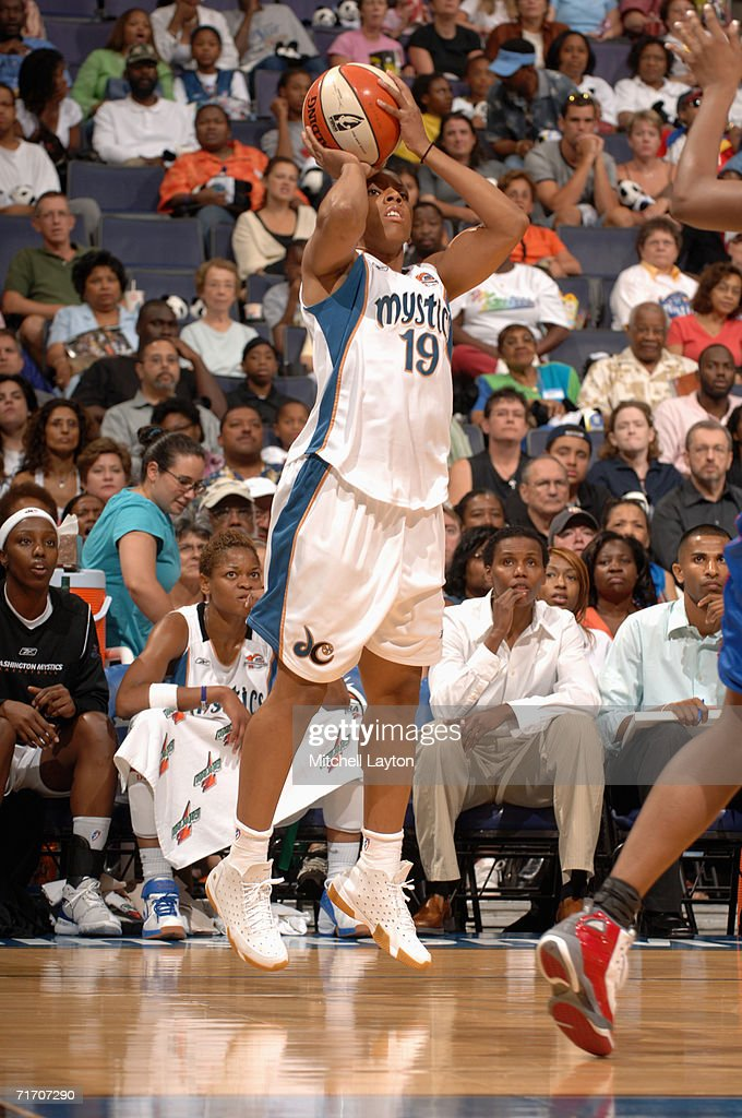 Nikki Blue #19 of the Washington Mystics shoots a jump shot during a game against the Detroit Shock at MCI Center on August 11, 2006 in Washington, D.C. The Mystics won 78-66.